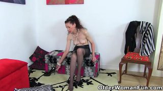 Skinny mature Scarlet is toying her dripping wet cunt